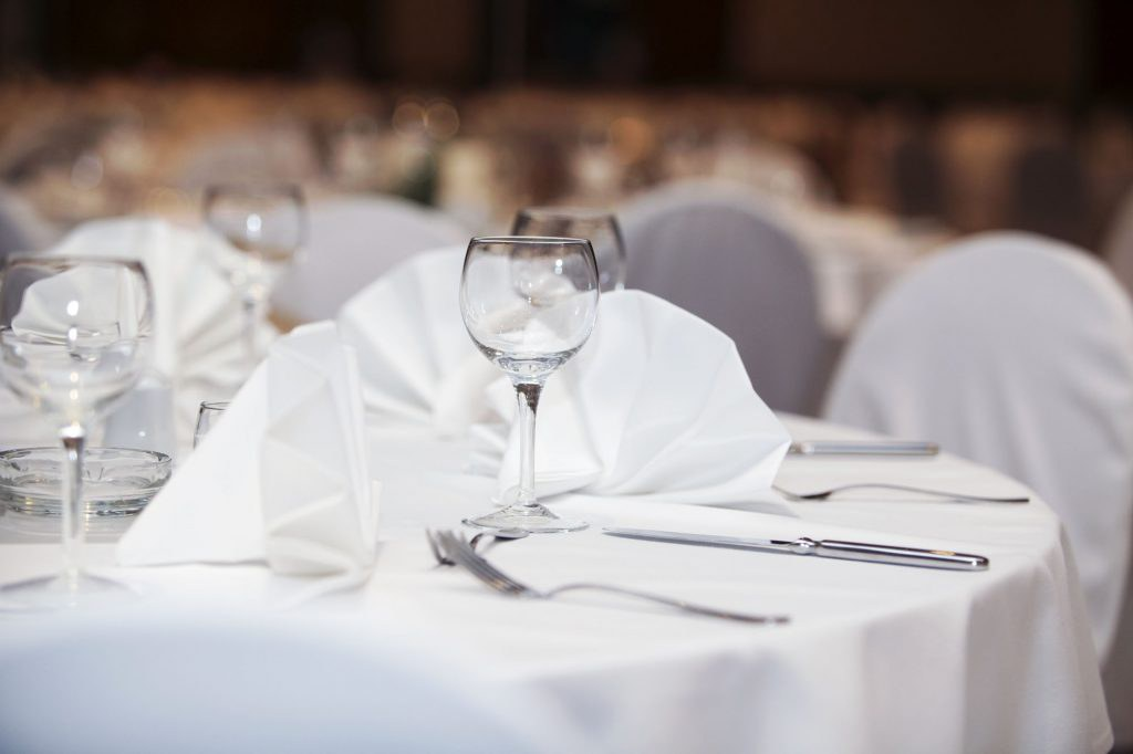 Elegant place setting with wineglasses, copy space